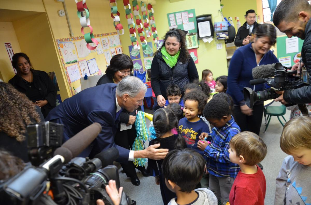 Gov. Jay Inslee with early learning students at El Centro de la Raza in Seattle, Wash., Dec. 15, 2106. (Official Governor's Office Photo)