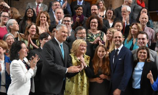 Gov. Inslee and First Lady Trudi celebrate with legislators and higher education stakeholders after signing Washington's Workforce Education Investment Act.
