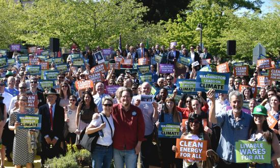 Gov. Inslee rallies with hundreds of supporters in celebration of Washington's new clean energy laws.