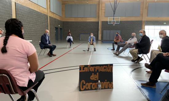 Gov. Inslee on a basketball court, meeting with leaders from Wenatchee