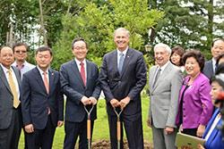Governor Inslee, Governor Song of Jeollabuk-Do and former Governor Mike Lowry plant a tree in recognition of the sister state relationship between Washington state and Jeollabuk-Do South Korea.
